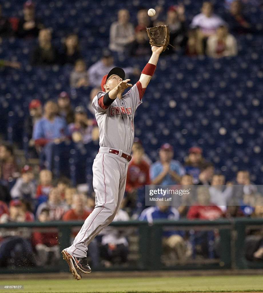 Third baseman <a gi-track='captionPersonalityLinkClicked' href=/galleries/search?phrase=Todd+Frazier&family=editorial&specificpeople=4778756 ng-click='$event.stopPropagation()'>Todd Frazier</a> #21 of the Cincinnati Reds catches the ball in the bottom of the ninth inning against the Philadelphia Phillies on May 16, 2014 at Citizens Bank Park in Philadelphia, Pennsylvania.
