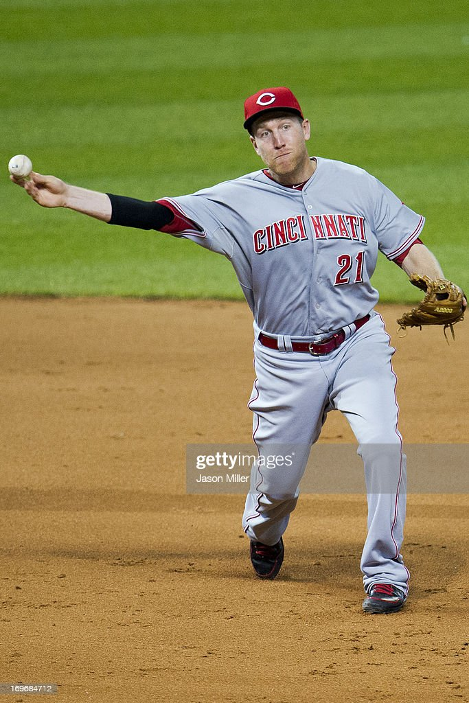 Third baseman <a gi-track='captionPersonalityLinkClicked' href=/galleries/search?phrase=Todd+Frazier&family=editorial&specificpeople=4778756 ng-click='$event.stopPropagation()'>Todd Frazier</a> #21 of the Cincinnati Reds throws to first on a ground ball hit by Michael Bourn #24 of the Cleveland Indians during the sixth inning at Progressive Field on May 30, 2013 in Cleveland, Ohio. The Indians defeated the Reds 7-1.