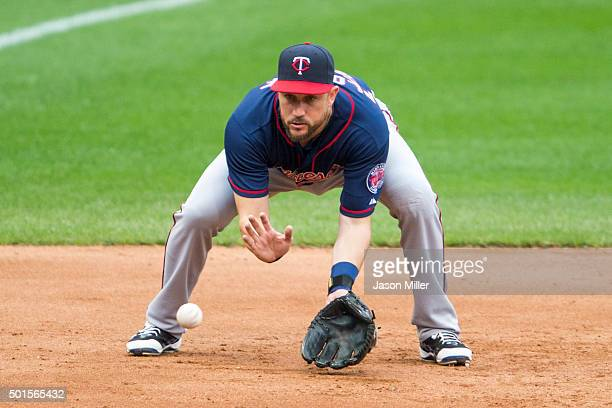 Third baseman Trevor Plouffe of the Minnesota Twins fields a ground ball during the game against the Cleveland Indians at Progressive Field during...