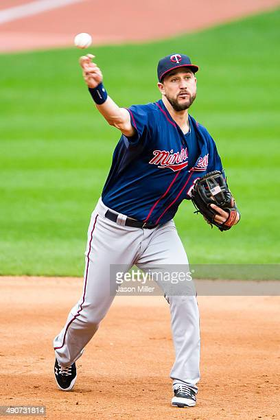 Third baseman Trevor Plouffe of the Minnesota Twins throws out Jesus Aguilar of the Cleveland Indians at first base during the fifth inning at...