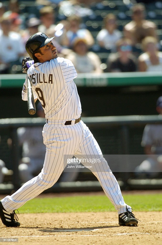 Third baseman Vinny Castilla of the Colorado Rockies bats during the MLB game against the Milwaukee Brewers at Coors Field on July 1 2004 in Denver...