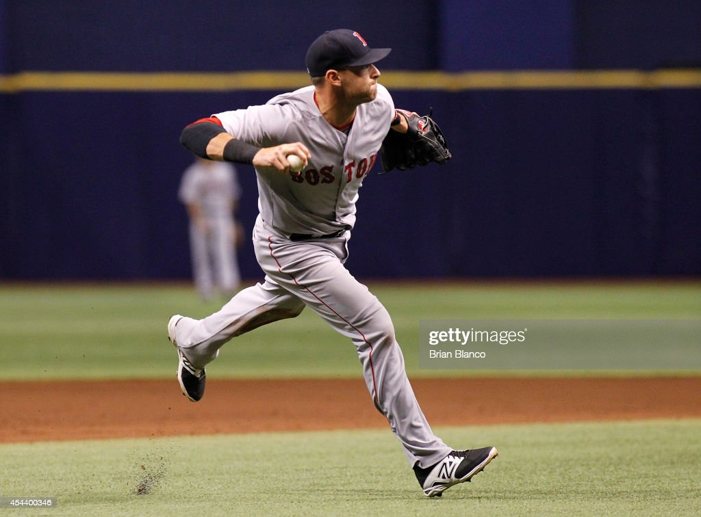 Third baseman <a gi-track='captionPersonalityLinkClicked' href=/galleries/search?phrase=Will+Middlebrooks&family=editorial&specificpeople=7934204 ng-click='$event.stopPropagation()'>Will Middlebrooks</a> #16 of the Boston Red Sox fields the single by Evan Longoria #3 of the Tampa Bay Rays during the fifth inning of a game on August 30, 2014 at Tropicana Field in St. Petersburg, Florida.