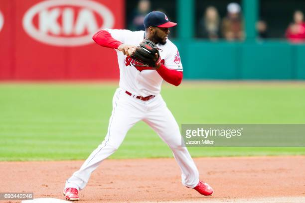 Third baseman Yandy Diaz of the Cleveland Indians attempts to throw out Cody Asche of the Chicago White Sox at first as Melky Cabrera is out at...