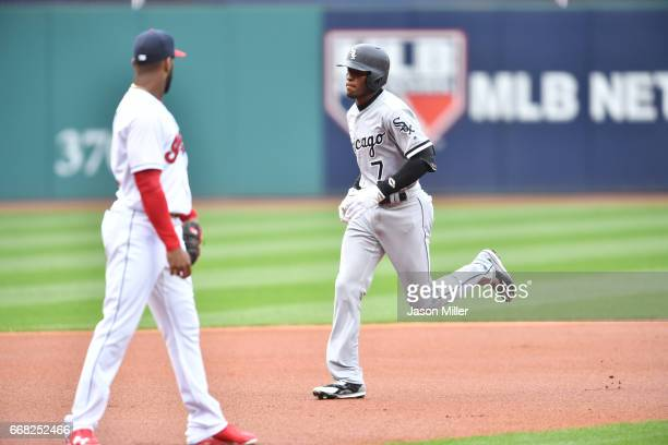 Third baseman Yandy Diaz of the Cleveland Indians watches as Tim Anderson of the Chicago White Sox rounds the bases after hitting a solo home run off...