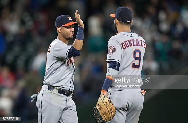 Third baseman Yulieski Gurriel left of the Houston Astros is congratulated by first baseman Marwin Gonzalez of the Houston Astros after a victory...