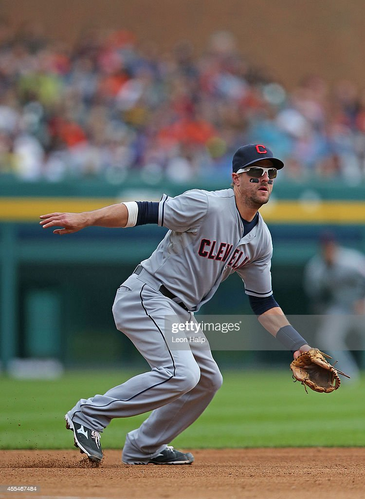 Third basemen Lonnie Chisenhall of the Cleveland Indians fields the ground ball during the third inning of the game against the Detroit Tigers at...