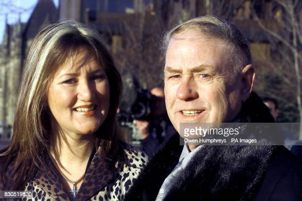 Third Division's Darlington Football club chairman George Reynolds with his wife Susan arrive outside Middlesbrough High Court for the start of the...