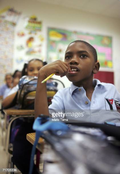 Third grade student Thaddeus Rhodes sits in class at the Dryades YMCA James M Singleton Charter School August 23 2006 in New Orleans Louisiana Fall...