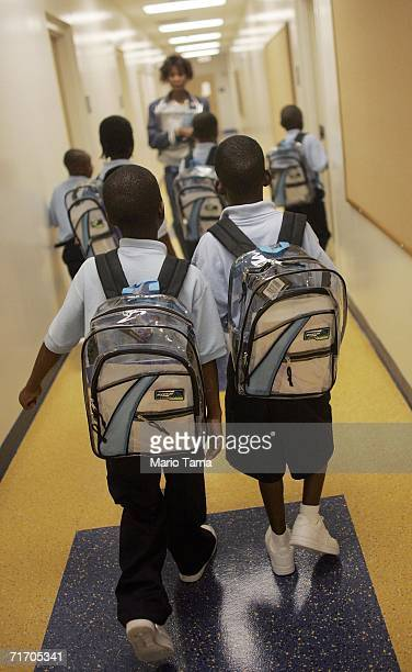 Third grade students at the Dryades YMCA James M Singleton Charter School wear matching donated backpacks as they walk through the halls August 23...