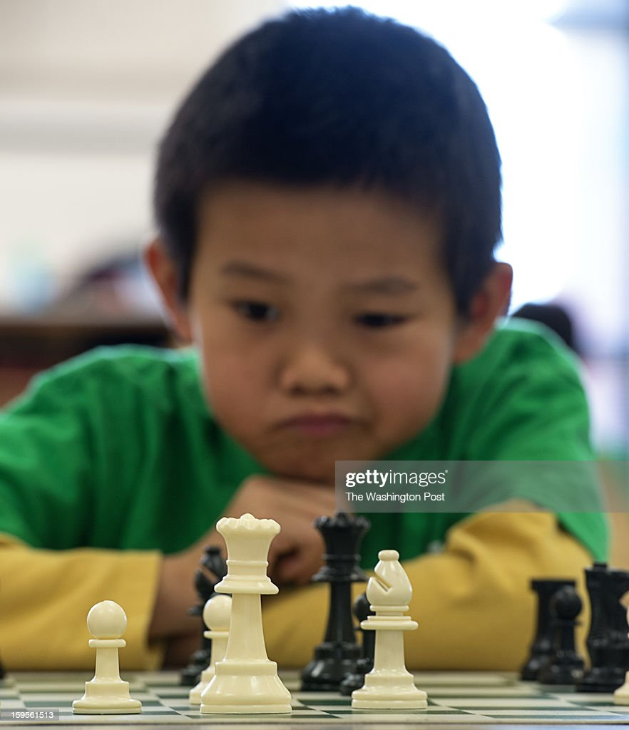 Third grader Andrew Wang contemplates his next move against his opponent in the school cafeteria at Greenbriar West Elementary School in Chantilly, Virginia on January 07, 2013.