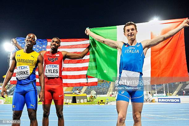 Third Mario Burke from Barbados and winner Noah Lyles from USA and second Filippo Tortu from Italy pose with national flags after Men's 100 meters...