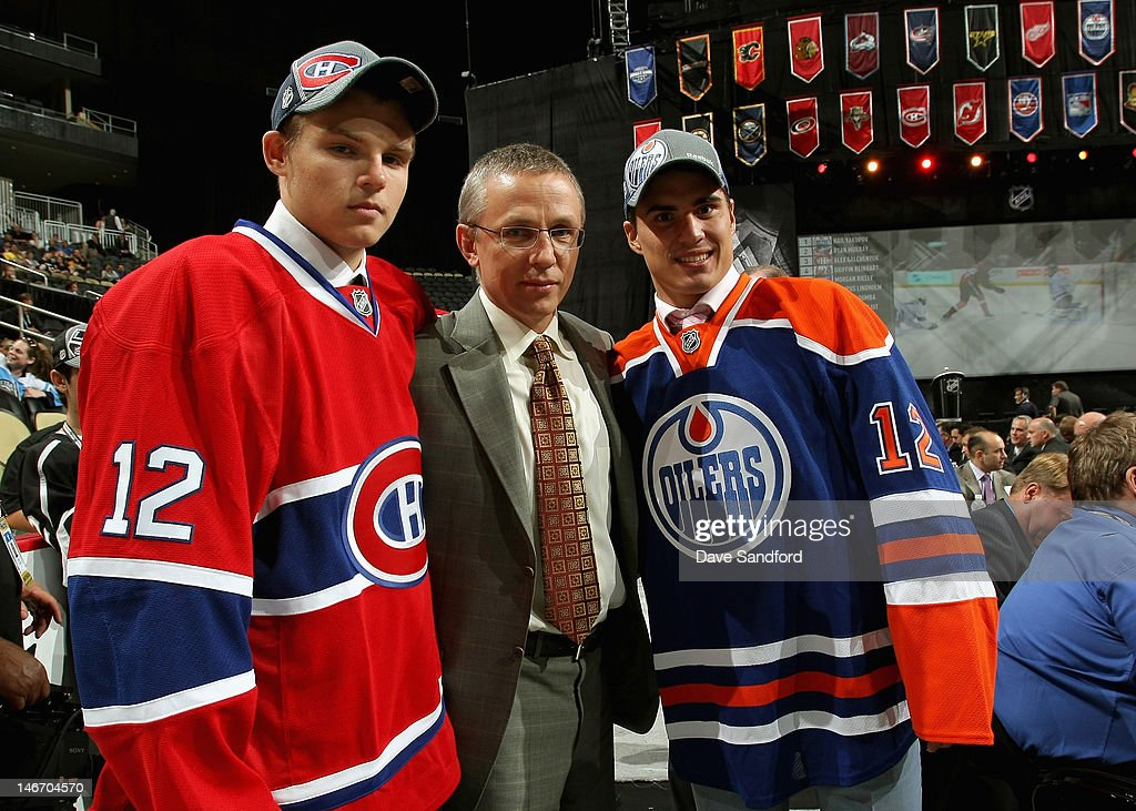 Third overall pick, Alex Galchenyuk of the Montreal Canadiens, <a gi-track='captionPersonalityLinkClicked' href=/galleries/search?phrase=Igor+Larionov&family=editorial&specificpeople=201768 ng-click='$event.stopPropagation()'>Igor Larionov</a> and first overall pick Nail Yakupov of the Edmonton Oilers pose together during Round One of the 2012 NHL Entry Draft at Consol Energy Center on June 22, 2012 in Pittsburgh, Pennsylvania.