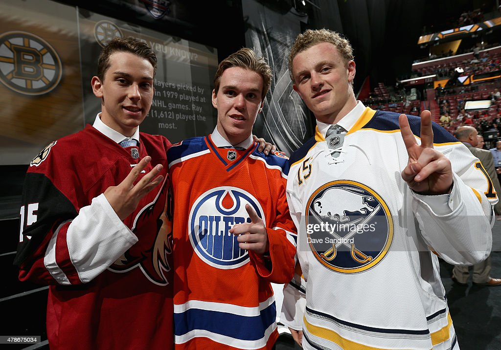 Third overall pick <a gi-track='captionPersonalityLinkClicked' href=/galleries/search?phrase=Dylan+Strome&family=editorial&specificpeople=11526714 ng-click='$event.stopPropagation()'>Dylan Strome</a> of the the Arizona Coyotes, first overall pick <a gi-track='captionPersonalityLinkClicked' href=/galleries/search?phrase=Connor+McDavid&family=editorial&specificpeople=9756794 ng-click='$event.stopPropagation()'>Connor McDavid</a> of the Edmonton Oilers and second overall pick Jacck Eichel of the Buffalo Sabres pose together during Round One of the 2015 NHL Draft at BB&T Center on June 26, 2015 in Sunrise, Florida.