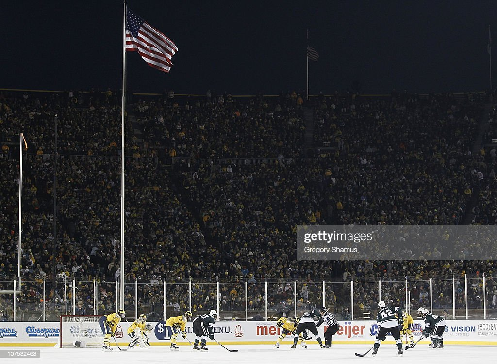 A third period faceoff takes place between the Michigan Wolverines and Michigan State Spartans during their outdoor game at Michigan Stadium on December 11, 2010 in Ann Arbor, Michigan.