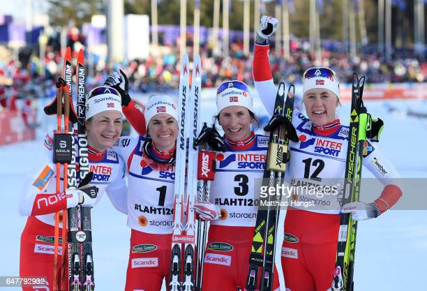 Third place Astrid Uhrenholdt Jacobsen of Norway second placed Heidi Weng of Norway first place Marit Bjoergen of Norway and fourth place Ragnhild...