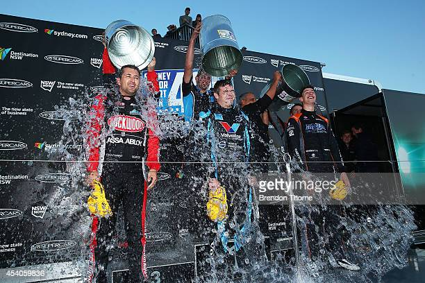 Third place Fabian Coulthard driver ofthe Lockwood Racing Holden first place Scott McLaughlin driver of the Valvoline Racing GRM Volvo and second...
