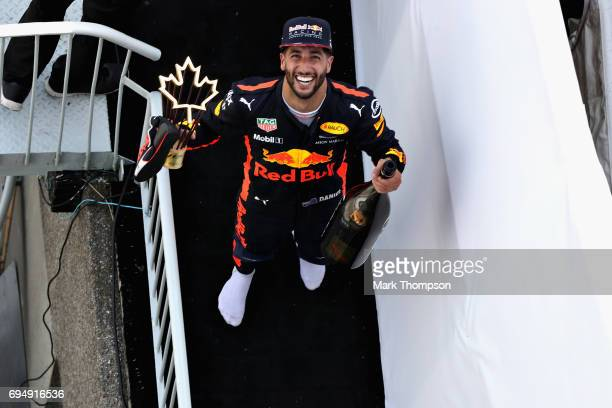 Third place finisher Daniel Ricciardo of Australia and Red Bull Racing celebrates on the podium during the Canadian Formula One Grand Prix at Circuit...