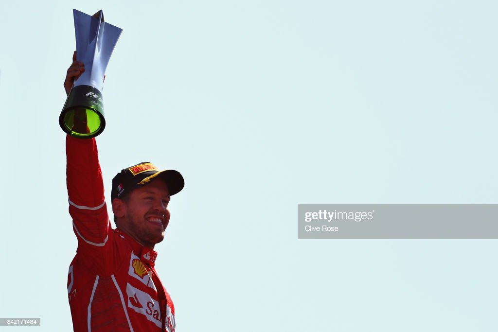Third place finisher Sebastian Vettel of Germany and Ferrari celebrates on the podium during the Formula One Grand Prix of Italy at Autodromo di Monza on September 3, 2017 in Monza, Italy.
