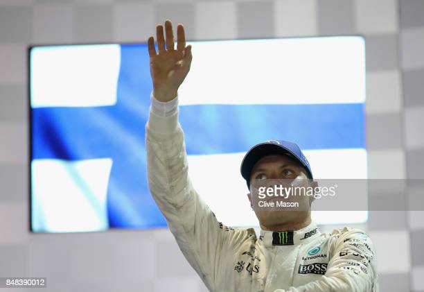 Third place finisher Valtteri Bottas of Finland and Mercedes GP celebrates on the podium during the Formula One Grand Prix of Singapore at Marina Bay...