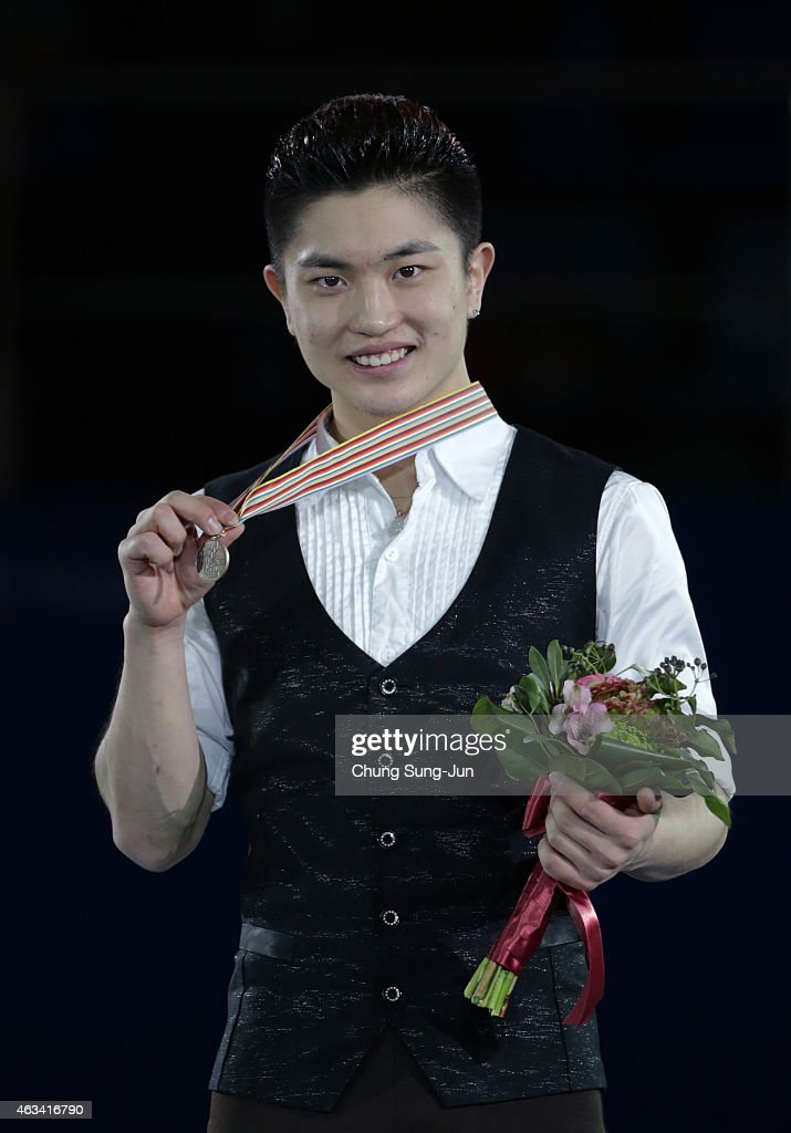 Third place Han Yan of China poses on the podium after the medals ceremony of the Men Skating on day three of the ISU Four Continents Figure Skating Championships 2015 at the Mokdong Ice Rink on February 14, 2015 in Seoul, South Korea.