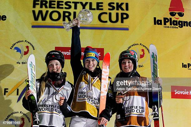 Third place Maxime DufourLapointe of Canada first place Hannah Kearney of the USA with the Overall Freestyle World Cup globe and second place winner...