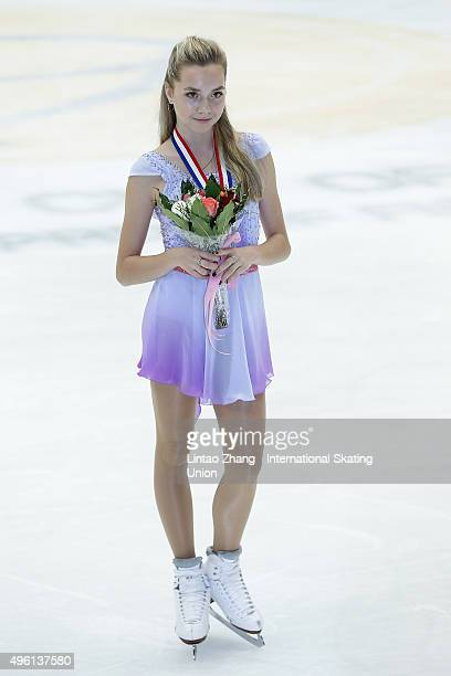 Third place winner Elena Radionova of Russia pose on the podium after the medals ceremony of the Ladies Short Program on day two of Audi Cup of China...