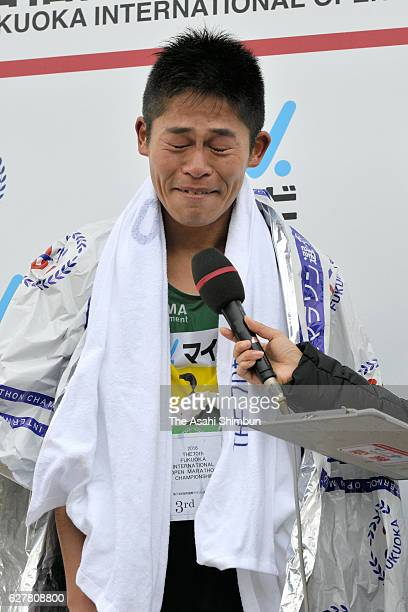 Third place Yuki Kawauchi of Japan is interviewed after competing in the Fukuoka International Marathon at Heiwadai Stadium on December 4 2016 in...