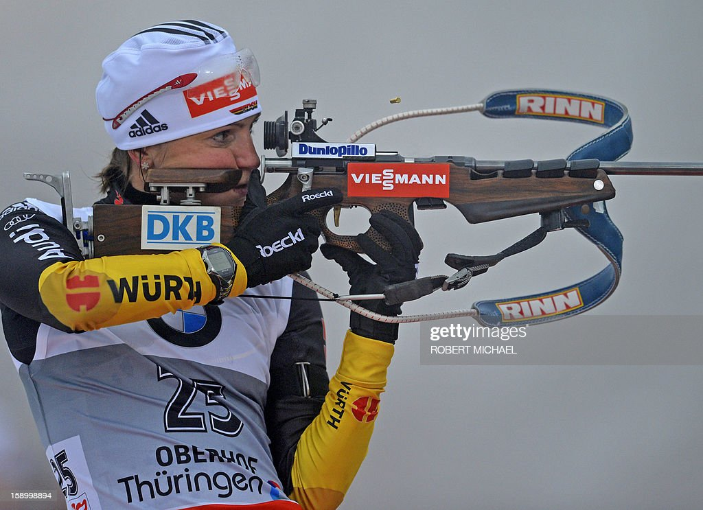 Third placed Andrea Henkel of Germany prepares at shooting range prior to the women's 7,5 km sprint event of the IBU biathlon World Cup in Oberhof, eastern Germany, on January 5, 2013. Germany's Miriam Goessner won ahead of Norway's Tora Berger and Henkel.