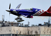 Third placed Australian Matt Hall of the Matt Hall Racing with his MXS plane competes during the Red Bull Air Race World Championship over the river...