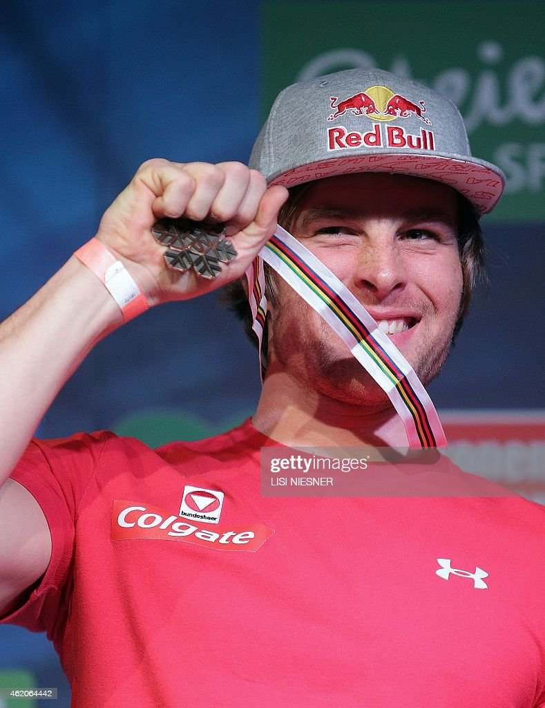 Third placed Austria's <a gi-track='captionPersonalityLinkClicked' href=/galleries/search?phrase=Benjamin+Karl&family=editorial&specificpeople=4586461 ng-click='$event.stopPropagation()'>Benjamin Karl</a> celebrates on the podium after he received his silver medal for the Men's Snowboard Parallel Giant Slalom of FIS Freestyle and Snowboarding World Ski Championships 2015 in Kreischberg on January 23, 2015.