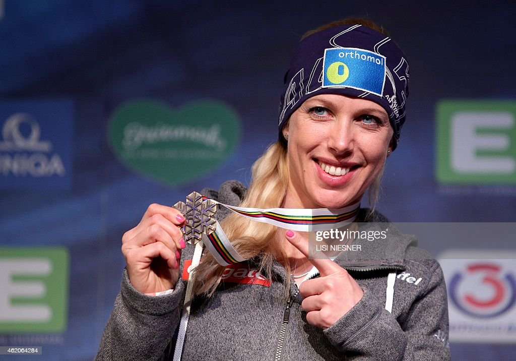 Third placed Austria's <a gi-track='captionPersonalityLinkClicked' href=/galleries/search?phrase=Marion+Kreiner&family=editorial&specificpeople=3071138 ng-click='$event.stopPropagation()'>Marion Kreiner</a> celebrates on the podium after the Women's Snowboard Parallel Slalom Finals at the FIS Freestyle and Snowboarding World Ski Championships 2015 in Kreischberg on January 23, 2015.