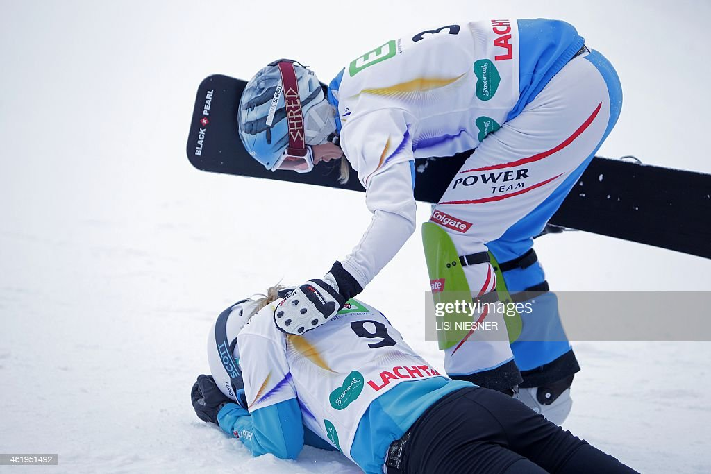 Third placed Austria's <a gi-track='captionPersonalityLinkClicked' href=/galleries/search?phrase=Marion+Kreiner&family=editorial&specificpeople=3071138 ng-click='$event.stopPropagation()'>Marion Kreiner</a> (R) consoles fourth placed Germany's <a gi-track='captionPersonalityLinkClicked' href=/galleries/search?phrase=Selina+Joerg&family=editorial&specificpeople=2203884 ng-click='$event.stopPropagation()'>Selina Joerg</a> after the Women's Snowboard Parallel Slalom Finals at the FIS Freestyle and Snowboarding World Ski Championships 2015 in Lachtal near Kreischberg, Austria on January 22, 2015.