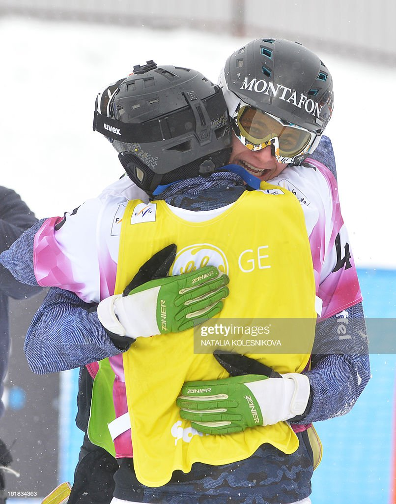 Third placed Austria's Markus Schairer and his teammate (R) Alessandro Haemmerle (first place) react during the Snowboard Cross World Cup Men's Test Event at the Snowboard and Freestyle Center in Rosa Khutor near the Black Sea resort of Sochi, on February 17, 2013.