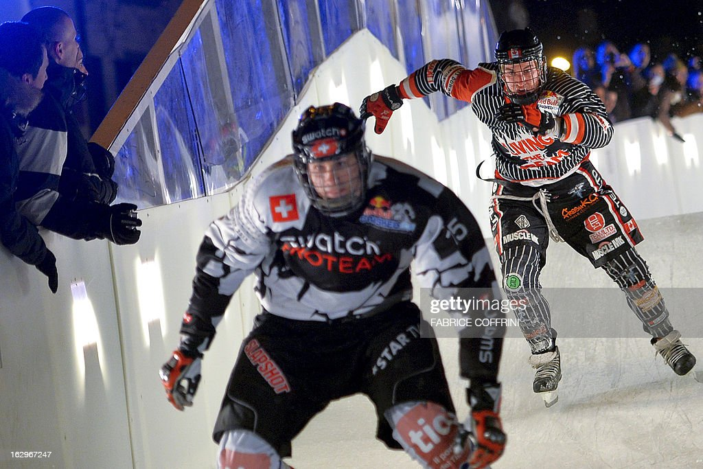 Third placed Canada's Scott Croxall (R) skates behind second placed Switzerland's Kim Mueller during the final race of the Ice Cross Downhill World Championship at the Red Bull Crashed Ice on March 2, 2013 in the old town of Lausanne, western Switzerland. 40'000 spectators watched the races.