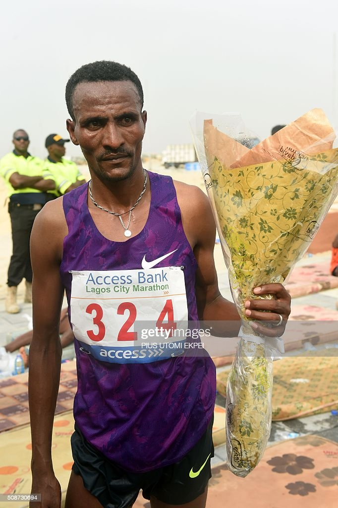 Third placed Ethiopian marathoner Debebe Tolsa is pictured at the end of the first Lagos City Marathon, on February 6, 2016 in Lagos. / AFP / PIUS UTOMI EKPEI