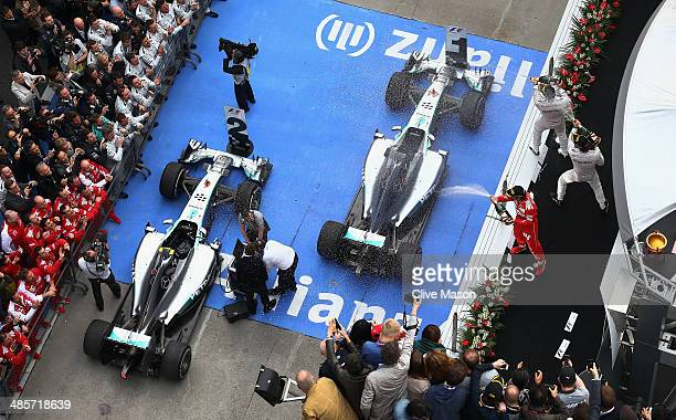 Third placed Fernando Alonso of Spain and Ferrari second placed Nico Rosberg of Germany and Mercedes GP and race winner Lewis Hamilton of Great...