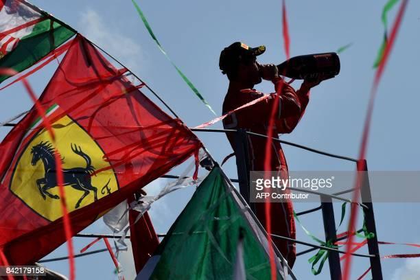 Third placed Ferrari's German driver Sebastian Vettel celebrates on the podium after the Italian Formula One Grand Prix at the Autodromo Nazionale...