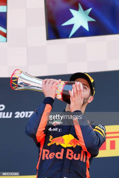 Third placed finisher Daniel Ricciardo of Australia and Red Bull Racing as he celebrates on the podium after the Spanish Formula One Grand Prix on...