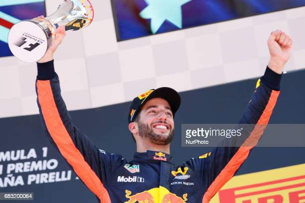 Third placed finisher Daniel Ricciardo of Australia and Red Bull Racing celebrates on the podium after the Spanish Formula One Grand Prix on May 14...