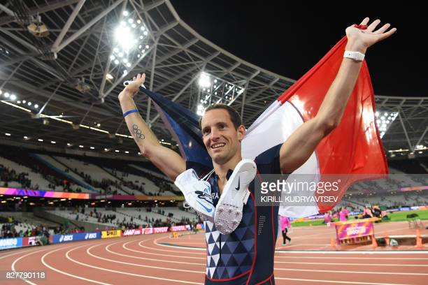 Third placed France's Renaud Lavillenie celebrates after the final of the men's pole vault athletics event at the 2017 IAAF World Championships at...