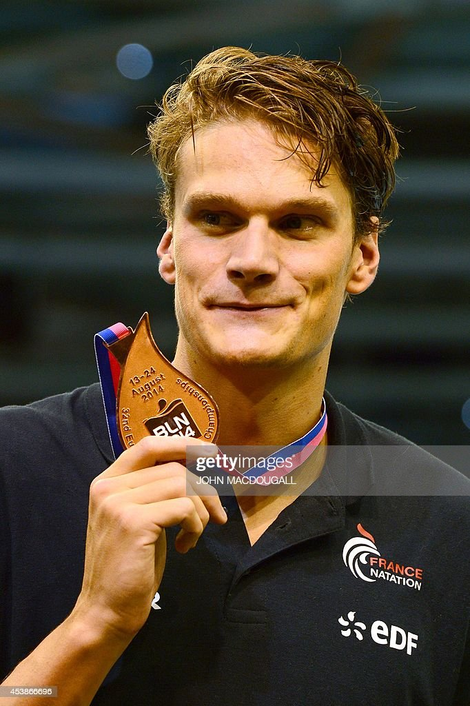 Third placed France's <a gi-track='captionPersonalityLinkClicked' href=/galleries/search?phrase=Yannick+Agnel&family=editorial&specificpeople=6567514 ng-click='$event.stopPropagation()'>Yannick Agnel</a> holds his medal as he celebrates on the podium after the men's 200m Freestyle final of the 32nd LEN European Swimming Championships on August 20, 2014 in Berlin.