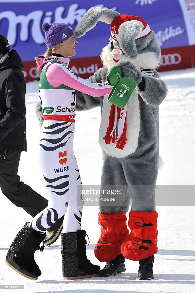 Third placed Germany's Maria-Hoefl-Riesch dances with a mascot after the women's downhill event of the 2013 Ski World Championships in Schladming, Austria on February 10, 2013.