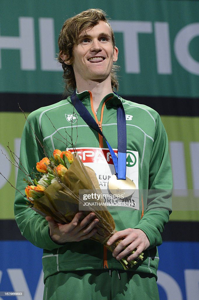 Third placed Ireland's Ciarán O Lionáird celebrates with his bronze medal on the podium after the men's 3000m final at the European Indoor athletics Championships in Gothenburg, Sweden, on March 2, 2013.
