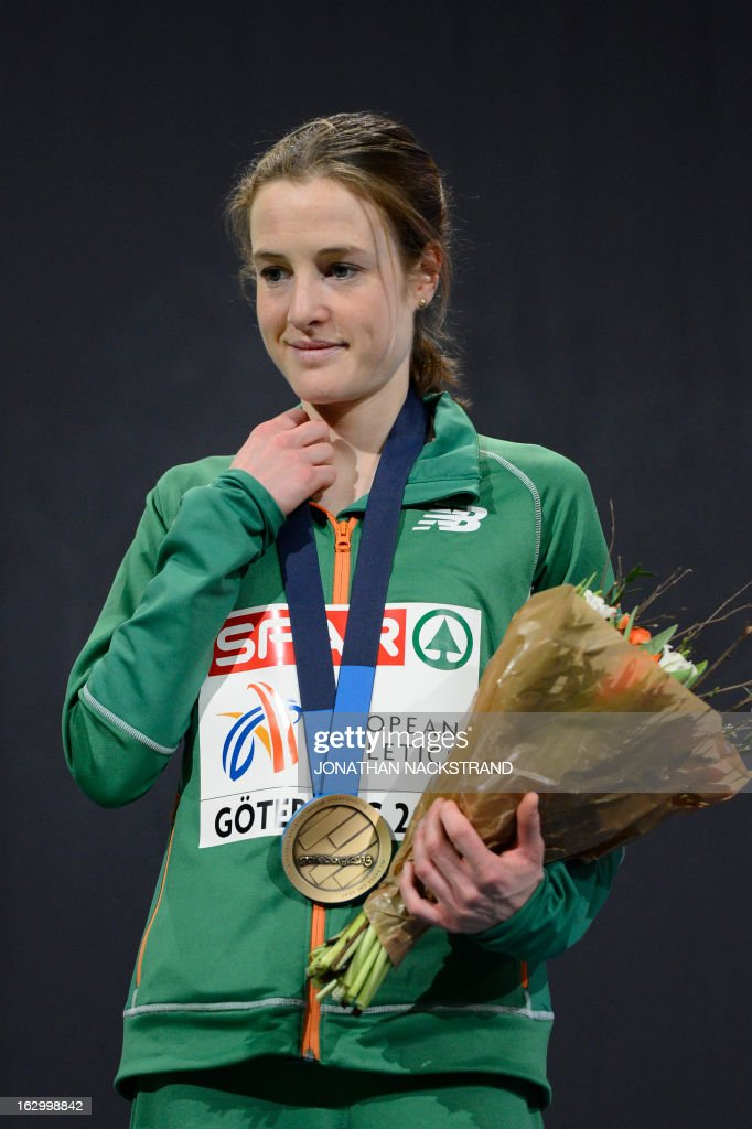 Third placed Ireland's Fionnuala Britton celebrates with her bronze medal on the podium after the Women's 3000m Final event at the European Indoor athletics Championships in Gothenburg, Sweden, on March 3, 2013.