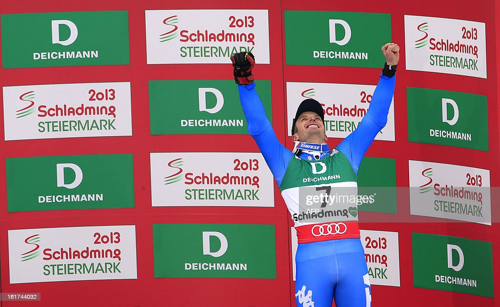 Third placed Italy's Manfred Moelgg poses on the podium after the men's Giant slalom at the 2013 Ski World Championships in Schladming, Austria on February 15, 2013. KLEIN