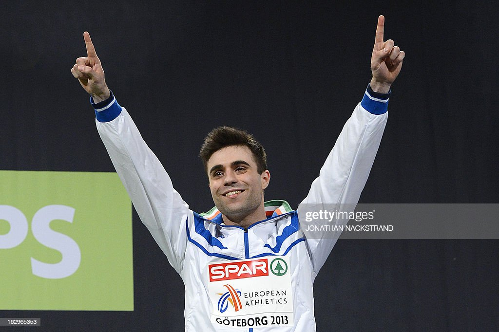 Third placed Italy's Michael Tumi celebrates on the podium after the men's 60m final at the European Indoor athletics Championships in Gothenburg, Sweden, on March 2, 2013.