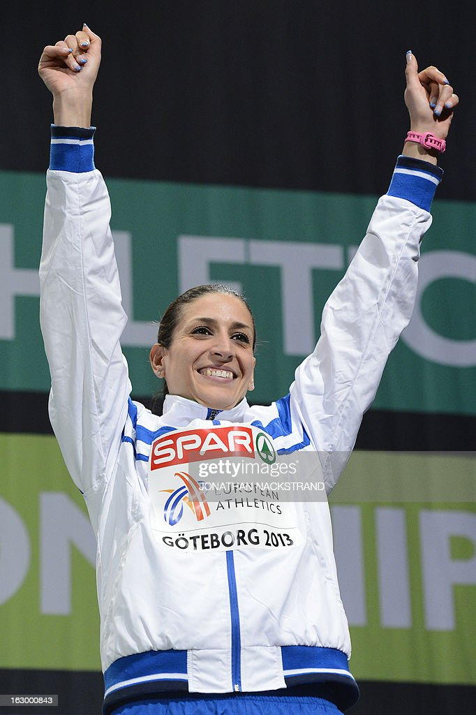 Third placed Italy's Simona La Mantia celebrates on the podium after the Women's Triple Jump Final at the European Indoor athletics Championships in Gothenburg, Sweden, on March 3, 2013.