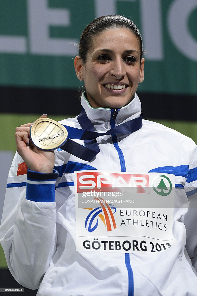Third placed Italy's Simona La Mantia celebrates with her bronze medal on the podium after the Women's Triple Jump Final at the European Indoor athletics Championships in Gothenburg, Sweden, on March 3, 2013.