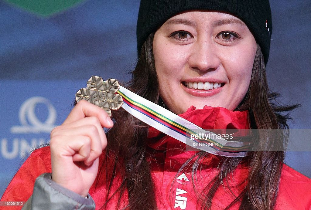 Third placed Japan's <a gi-track='captionPersonalityLinkClicked' href=/galleries/search?phrase=Tomoka+Takeuchi&family=editorial&specificpeople=6719453 ng-click='$event.stopPropagation()'>Tomoka Takeuchi</a> celebrates on the podium after she received her bronze medal FOR the Women's Snowboard Parallel Giant Slalom Finals of FIS Freestyle and Snowboarding World Ski Championships 2015 in Kreischberg on January 23, 2015.
