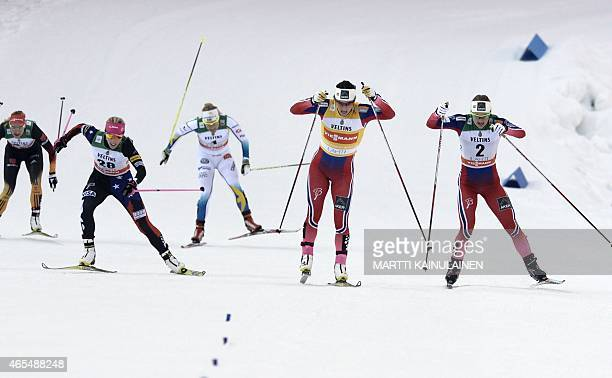 Third placed Kikkan Randall of USA winner Marit Björgen of Norway and second placed Ingvild Flugstad Ostberg of Norway in action FIS World Cup Ladies...